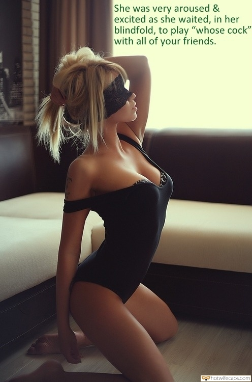 """Wife Sharing SFW Caps  hotwife caption: She was very aroused & excited as she waited, in her blindfold, to play """"whose cock"""" with all of your friends. Blindfolded Blonde Poses in Black Bodysuit"""